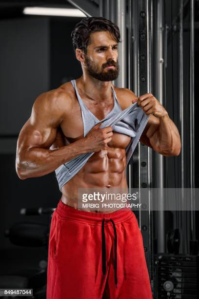 flexing muscles - handsome bodybuilders stock photos and pictures