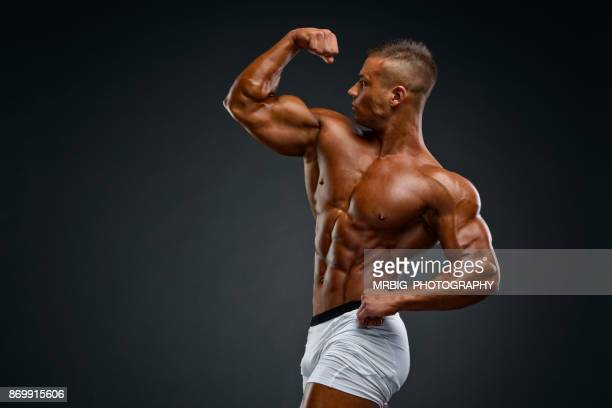 flexing muscles - body building stock pictures, royalty-free photos & images
