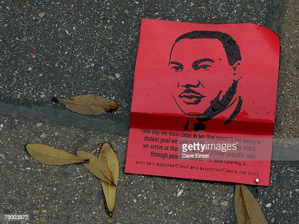A flier bearing the likeness of Martin Luther King Jr lies in the rain following the MLK Grande Parade January 15 2007 in Houston Texas An arctic...