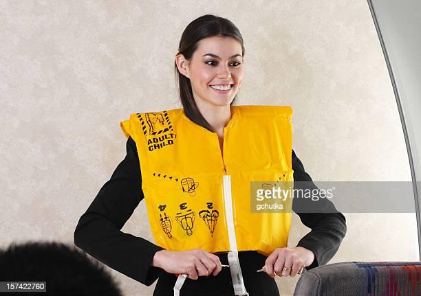 camarero de la vida y un chaleco de vuelo - life jacket photos fotografías e imágenes de stock
