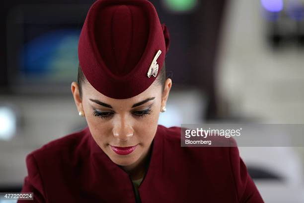 A flight attendant arranges a passenger booth in the first class cabin aboard an Airbus SAS A380 aircraft operated by Qatar Airways Ltd on the...