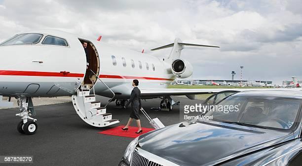 Flight attendant boarding corporate airplane