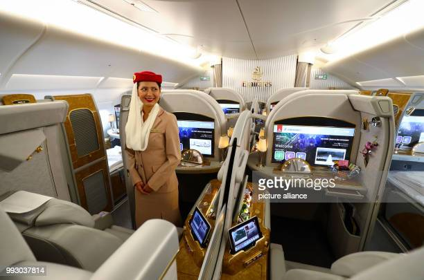 A flight attendant can be seen inside the first class cabin inside an Airbus A380 at the airbus factories in Hamburg Germany 3 November 2017 An...