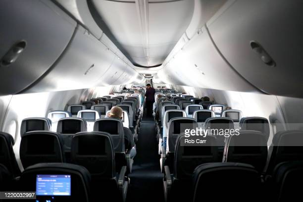 A flight attendant checks on passengers midflight on a Baltimore Maryland bound Delta flight from HartsfieldJackson Atlanta International Airport on...