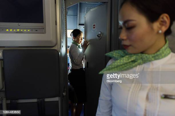 A flight attendant enters the cockpit on board an Airbus SE A321 Neo aircraft operated by FLC Group JSC's Bamboo Airways on the first day of the...