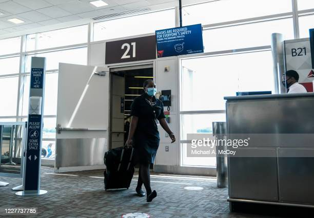 Flight attendant exits a Delta Airlines flight at the Ronald Reagan National Airport on July 22, 2020 in Arlington, Virginia. During the COVID-19...