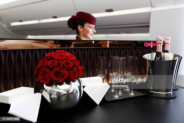 A flight attendant for Qatar Airways Ltd stands at the bar for business class passengers aboard an Airbus A350 XWB aircraft at the Singapore Airshow...