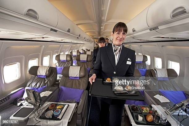 A flight attendant for the new airline Open Skies a 100 percent business class airline with authentic French cuisine poses on March 24 2010 at...