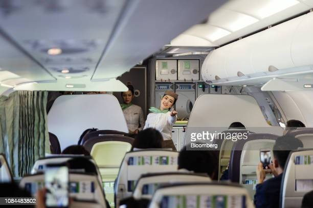 A flight attendant gestures to thank guests on board an Airbus SE A321 Neo aircraft operated by FLC Group JSC's Bamboo Airways on the first day of...