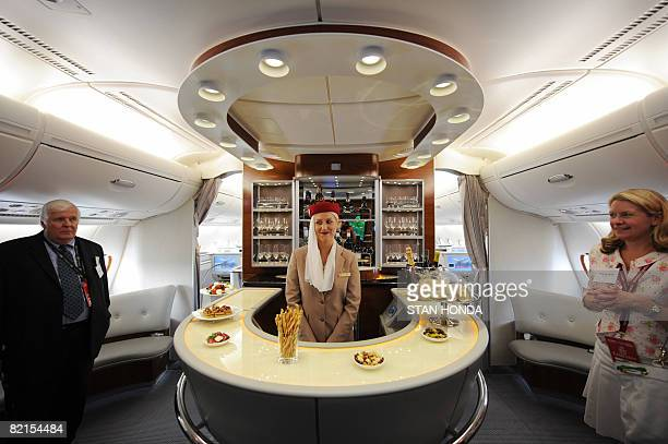 A flight attendant gives a tour to journalists in the business class lounge aboard an Emirates Airline A380 on August 1 2008 Emirates becomes the...