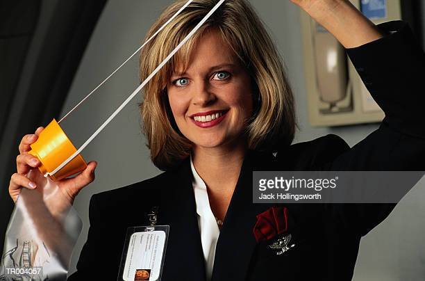 flight attendant giving mask demonstration - oxygen mask stock pictures, royalty-free photos & images