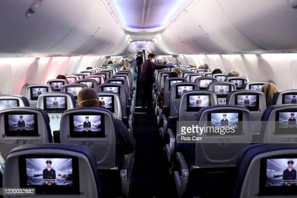 A flight attendant hands out headphones on a Baltimore Maryland bound Delta flight departing from HartsfieldJackson Atlanta International Airport on...