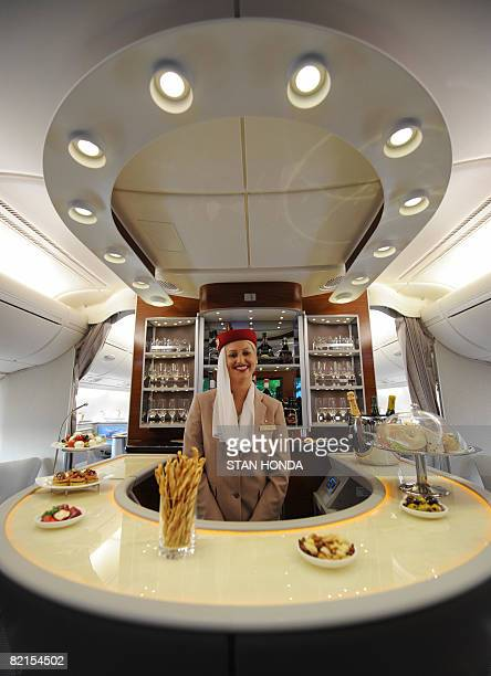 Flight attendant in the business class lounge aboard an Emirates Airlines A380 on August 1, 2008. Emirates becomes the first commercial Airbus A380...
