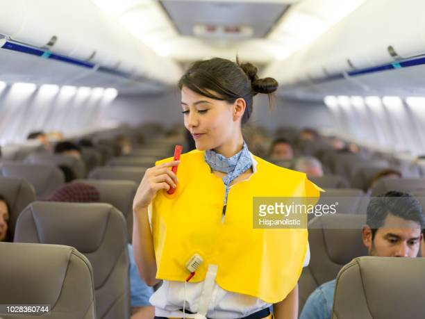 Flight attendant making an in-flight safety demonstration