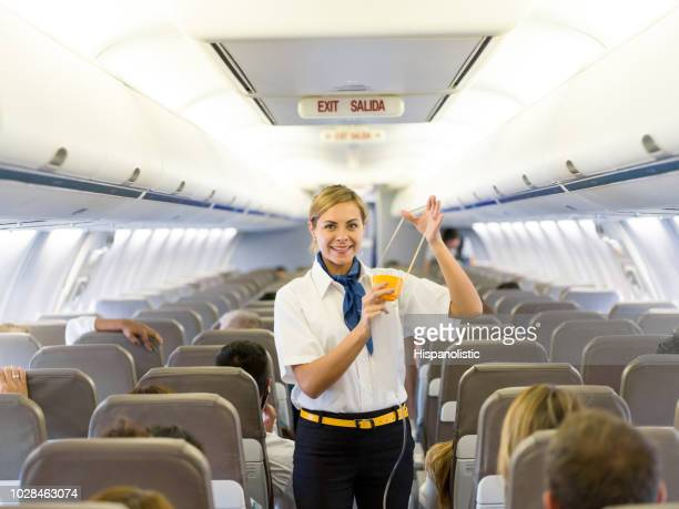 flight attendant making an in-flight safety demonstration - crew stock pictures, royalty-free photos & images