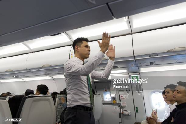 A flight attendant performs a safety demonstration on board an Airbus SE A321 Neo aircraft operated by FLC Group JSC's Bamboo Airways on the first...