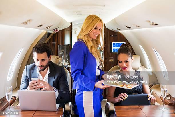 Flight attendant serving meal
