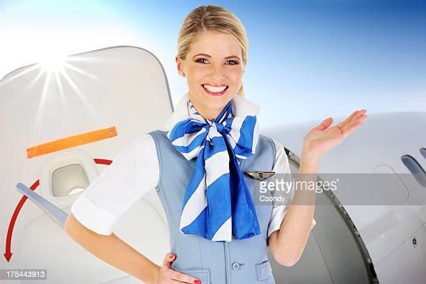 Flight attendant standing in the aircraft door