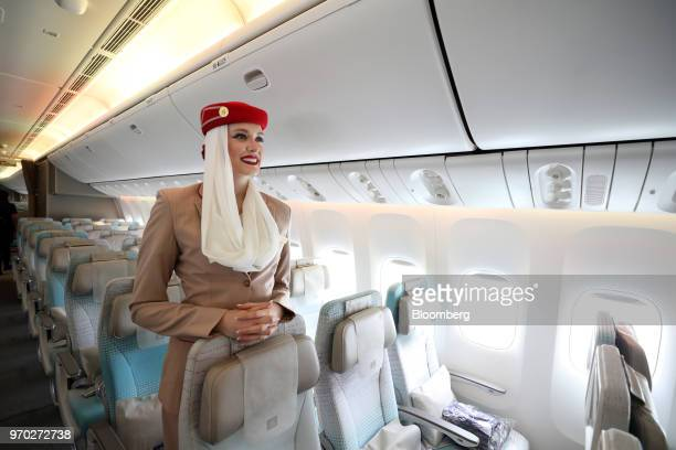 A flight attendant stands in the economy class cabin on board a Boeing Co777300ER passenger jetliner operated by Emirates Airline at London Stansted...
