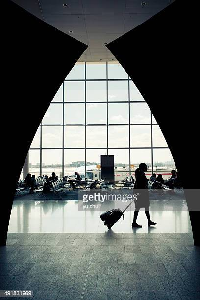 Flight attendant walking in Toronto pearson airport departure