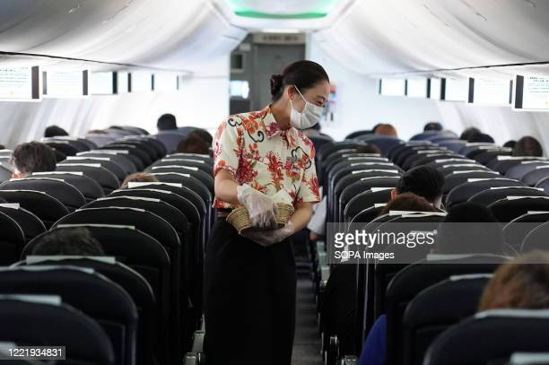 Flight attendant wearing a face mask as a preventive measure onboard at the Chubu Centrair International Airport. Japan's government lifted all...