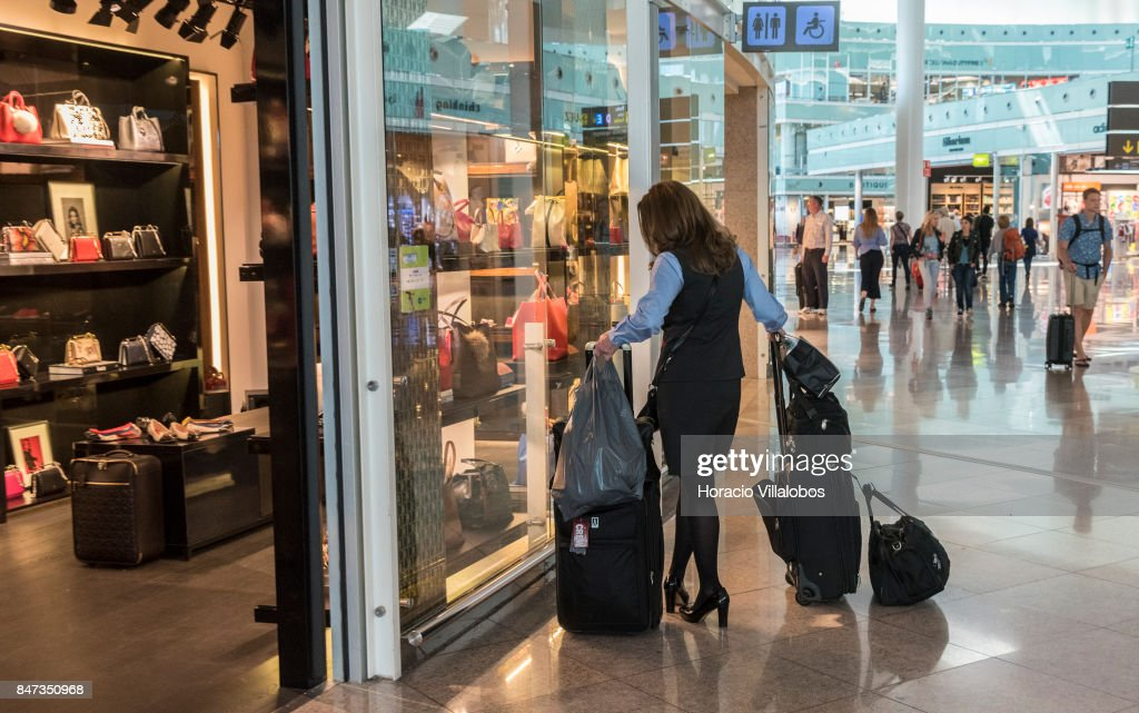 91114cc517 A flight attendant window-shops at Carolina Herrera store in... News ...