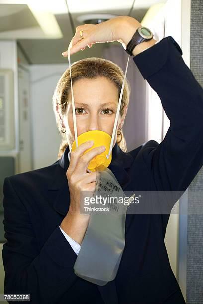 flight attendant with an oxygen mask - zuurstofmasker stockfoto's en -beelden