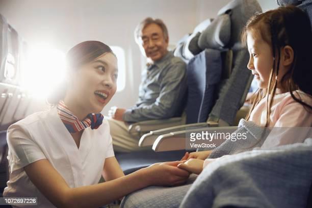 flight attendants and passengers on the plane - 乗員 ストックフォトと画像