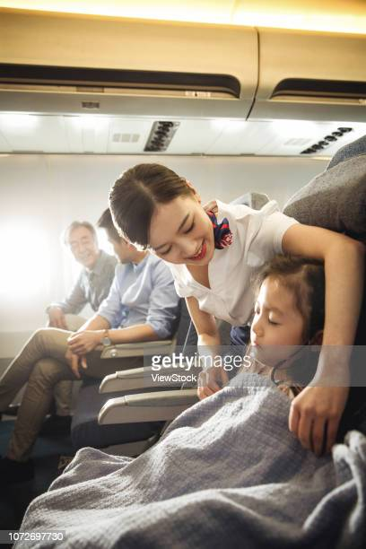 Flight attendants and passengers on the plane