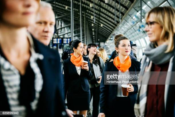 Flight attendants and travellers at the airport