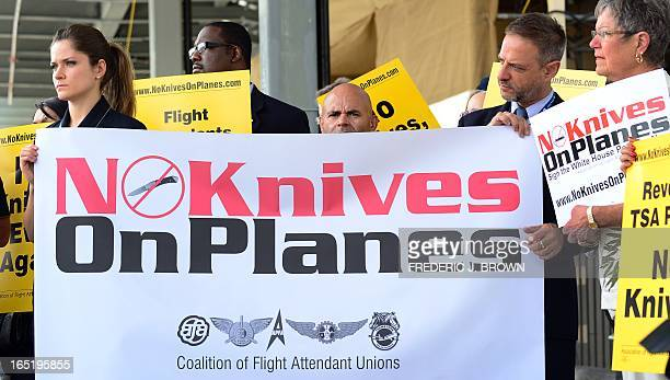 Flight attendants for US airlines hold banners and placards while picketing at Los Angeles International Airport's departure level demanding that...