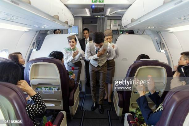 Flight attendants gesture to thank guests in the business class cabin on board an Airbus SE A321 Neo aircraft operated by FLC Group JSC's Bamboo...