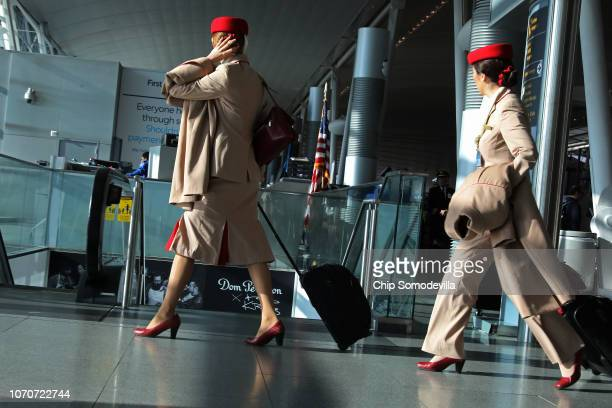 Flight attendants head for a flight at John F Kennedy Airport on the day before the Thanksgiving holiday November 21 2018 in Queens New York Holiday...