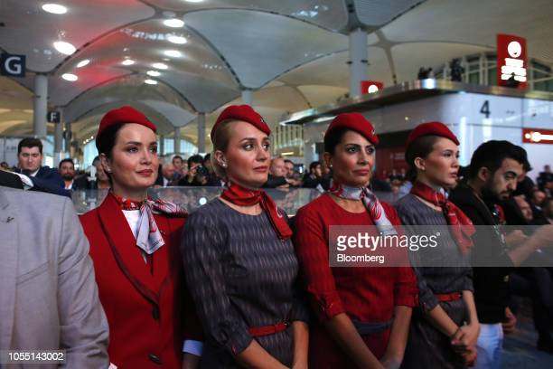 Flight attendants listen to a speech by Recep Tayyip Erdogan Turkey's president during the official opening ceremony for the new Istanbul Airport in...
