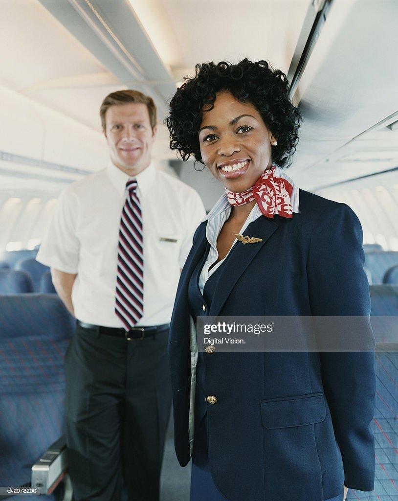 Flight Attendants on a Plane : Stock Photo