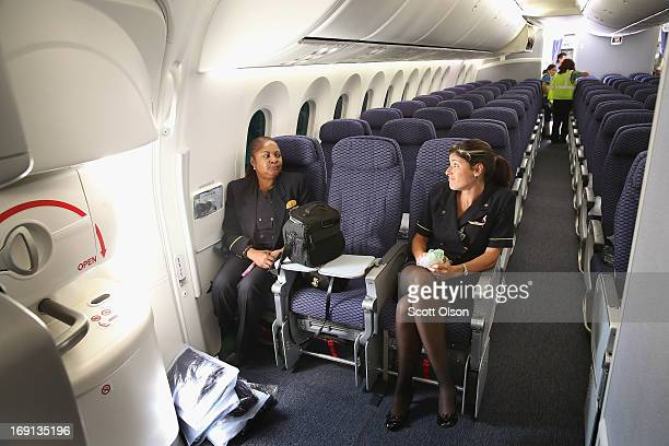 Flight attendants relax after arriving at O'Hare International Airport aboard a United Airlines Boeing 787 Dreamliner from Houston May 20 2013 in...