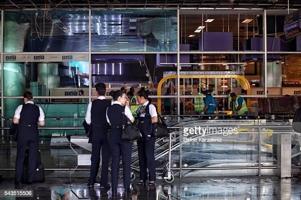Flight attendants wait outside the Turkey's largest airport Istanbul Ataturk Turkey June 29 Turkey Three suicide bombers opened fire before blowing...