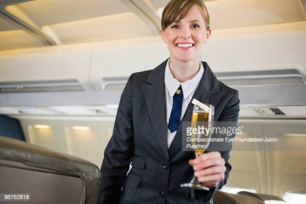 flight attendent holding glass