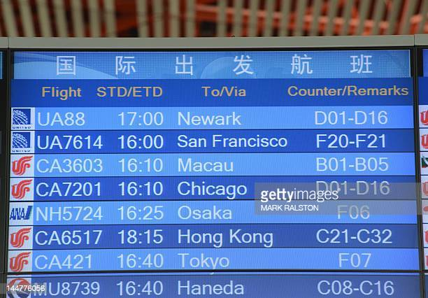A flight board shows United Airlines flight UA88 believed to be carrying blind rights activist Chen Guangcheng is seen at Beijing International...