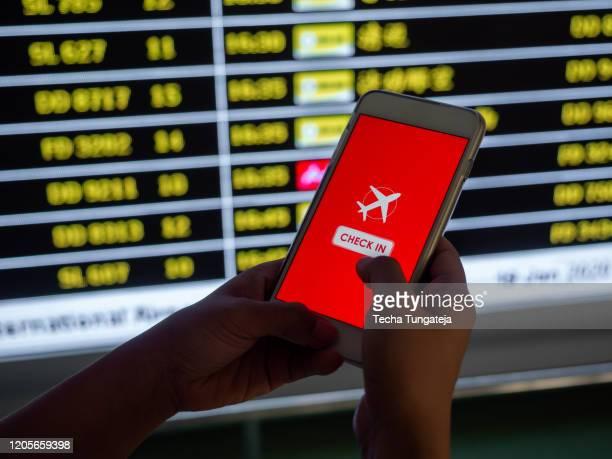 flight checkin mobile phone hand touching