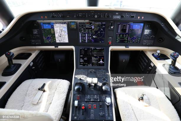 Flight controls are seen in the cockpit of an Embraer SA Legacy 500 jet during the Singapore Airshow held at the Changi Exhibition Centre in...