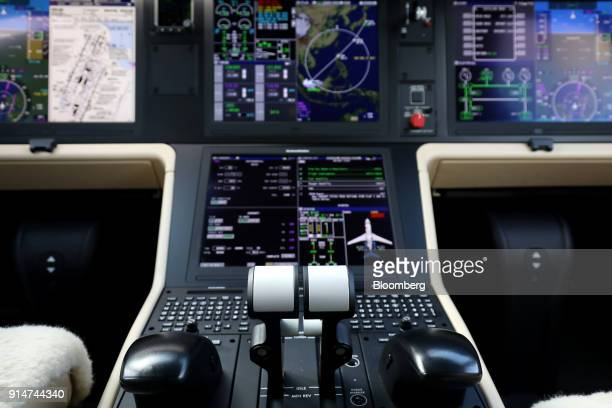 Flight controls are seen in the cockpit of an Embraer SA Legacy 500 jet during the the Singapore Airshow held at the Changi Exhibition Centre in...