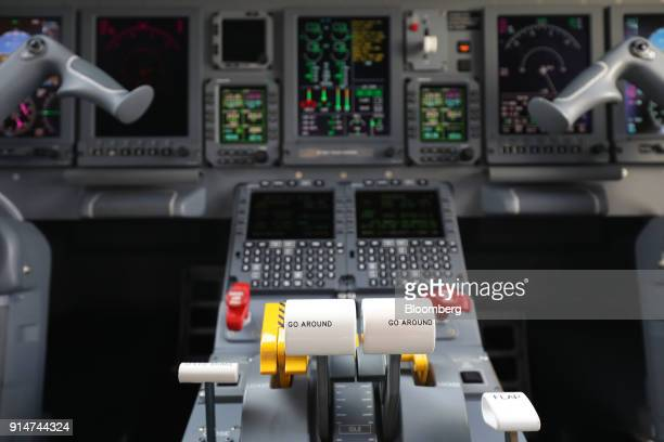 Flight controls are seen in the cockpit of an Embraer SA Legacy 650E jet during the Singapore Airshow held at the Changi Exhibition Centre in...