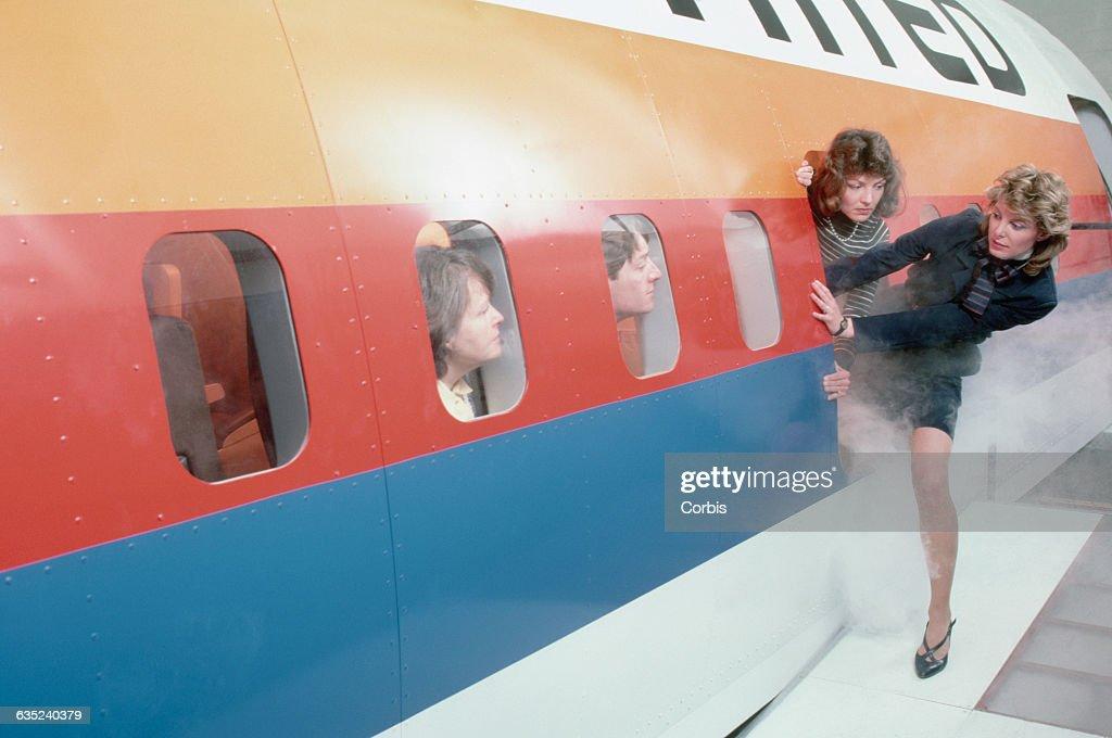 Flight crew aboard a United Boeing 767 flight simulator evacuate