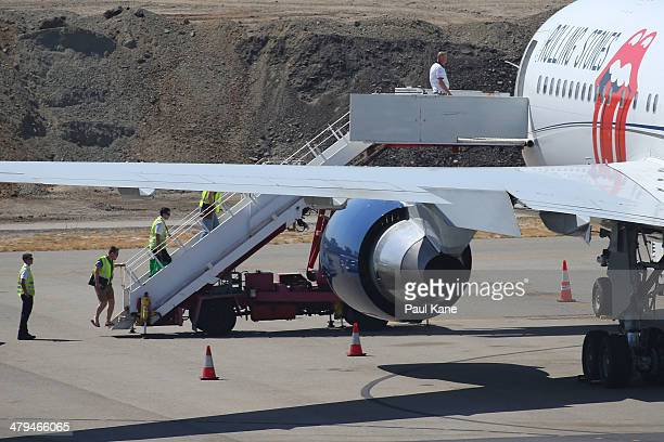 Flight crew are seen boarding the Aeronexus Corporation's Boeing 767 used by the Rolling Stones for preflight checks at Perth international airport...