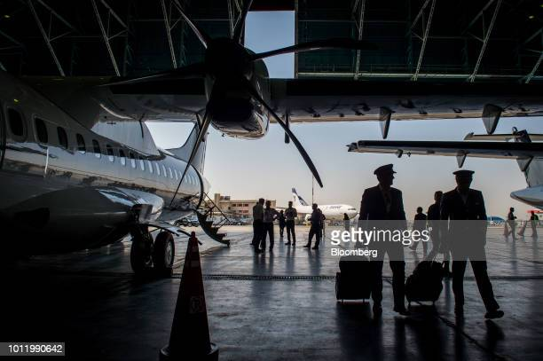 Flight crew disembark from a new twin engine ATR 72600 turboprop aircraft after landing at Mehrabad International airport in Tehran Iran on Sunday...
