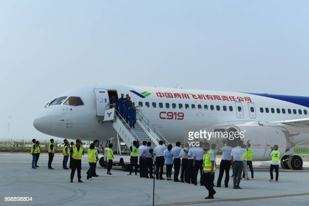 Flight crew members deplane after the No102 C919 passenger jet lands at Dongying Shengli Airport on July 12 2018 in Dongying Shandong Province of...