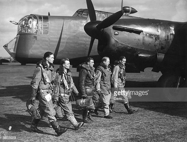 World War II British airforce bomber crew walking in front of aircraft Original Publication From left to right Observer Wireless Operator Rear Gunner...