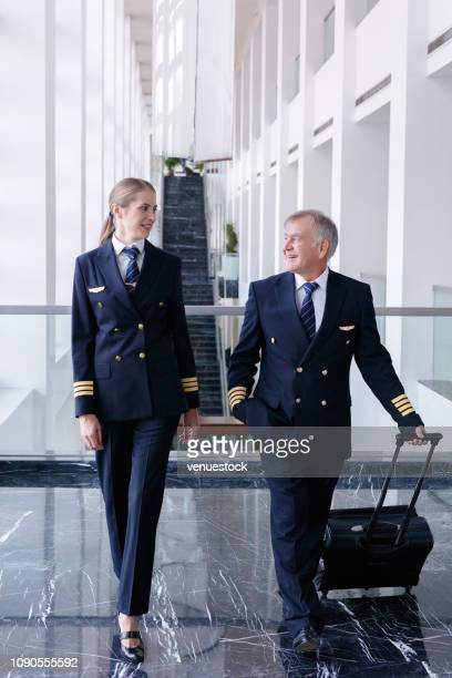 flight crew preparing to go to airplane - transportation occupation stock pictures, royalty-free photos & images