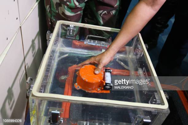 A flight data recorder part of the illfated Lion Air flight JT 610's black box is seen after it was recovered from the Java Sea during search...